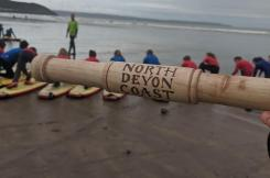 Relay baton and surfers